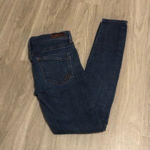 Express medium wash skinny jeans